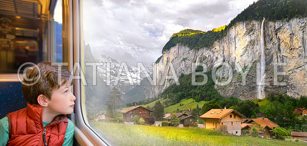 Boy looks at Lauterbrunnen Valley through train window