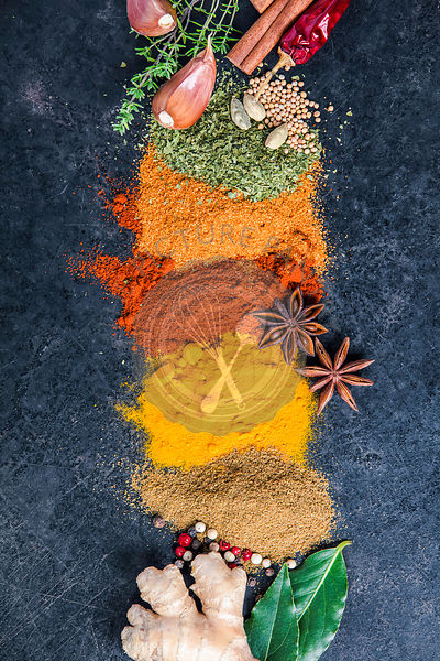Spices and herbs on a dark background. Paprika, parsley, cumin, curcuma, pepper, anice and mustard seeds. Cooking and healthy...