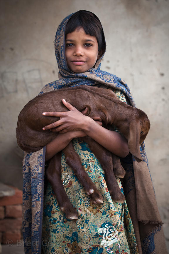 Girl and her goat in the rural village of Kharekhari, Rajasthan, India