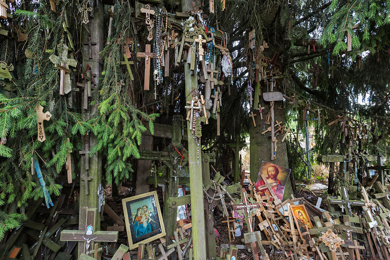 Framed Portraits among some of the Thousands of Crosses at the Hill of Crosses
