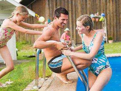 Germany, Bavaria, Family at swimming pool