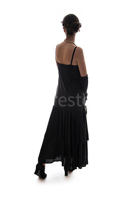 A semi-silhouette of a vintage 1920s - 1930s woman in a black dress – shot from eye level.