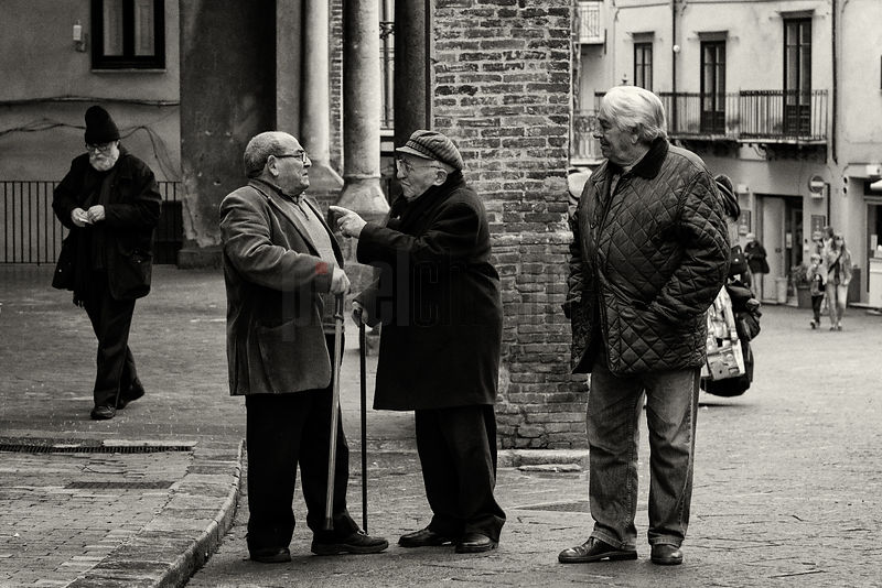 Men Having a Conversation in the Suquare at Castelbuono
