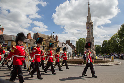 Irish Guards Bandsmen Marching past Banbury Cross