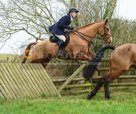 Meghan Healy Jumping a jump at Peake's. The Cottesmore Hunt at Bleak House 18/12