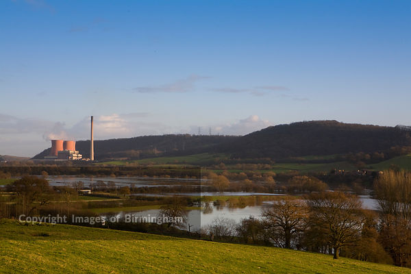 Views of the raising flood water on the river severn towards Ironbridge in Shropshire. Buildwas power station.