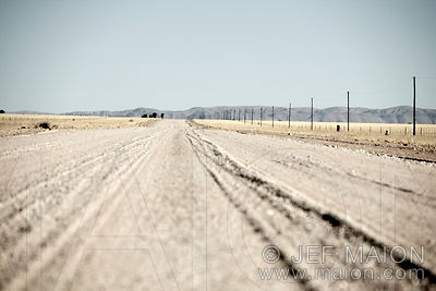 Dirt road and electricity poles