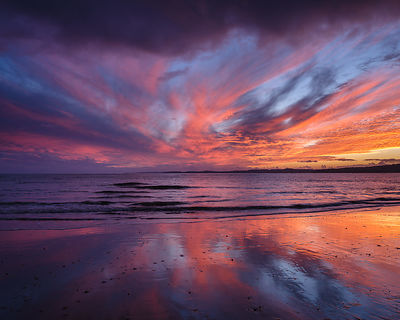 Vivid sunset afterglow over TOrbay viewed from Exmouth, Devon, UK.
