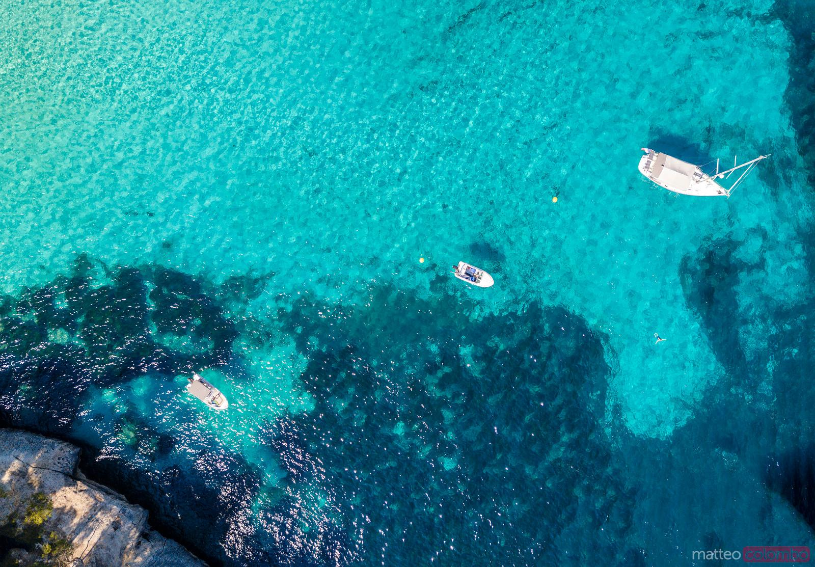 Aerial view of boats in the blue sea in summer