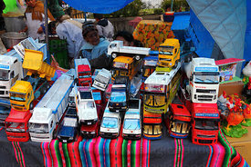 Model vehicles for sale on market stall, Alasitas festival, La Paz, Bolivia