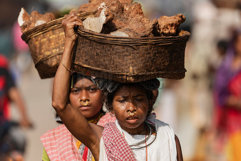 Portrait of Women Carrying Baskets of Tubers on their Heads