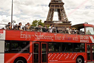 Tourists Pass by The Eiffel Tower on Bus