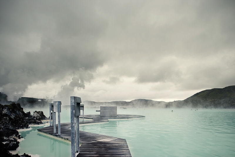 Tourists enjoy the Blue lagoon, Iceland's most famous geothermal spa.