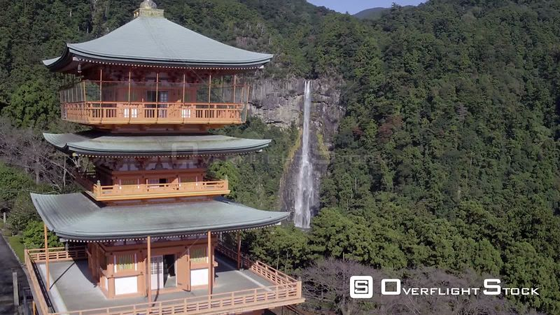 Aerial shot tracking towards Nachisan Seigantoji pagoda and Nachi Falls, Kumano Nachi Shrine, Wakayama, Japan, November 2017.