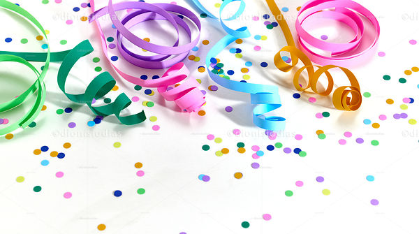 Colorful serpentines on a white background with confetti