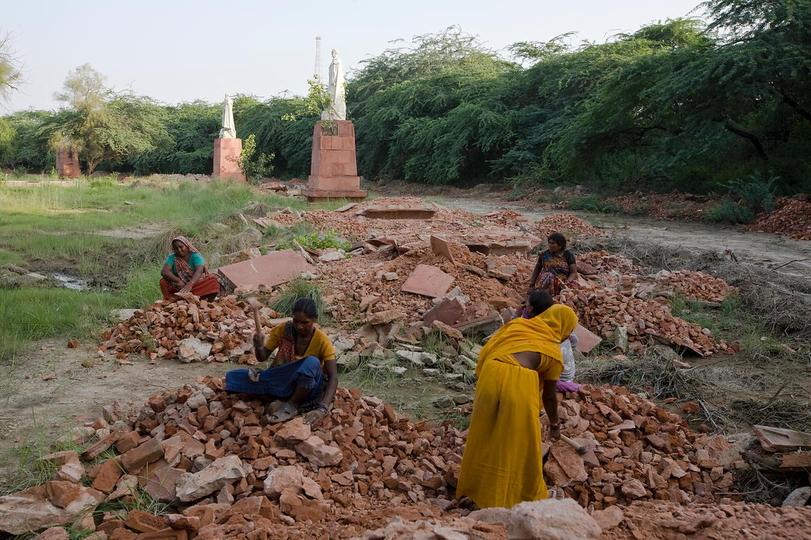 India - Delhi - Women demolish plinths and pavement around statues of King George V and other Imperial notables and Viceroys ...