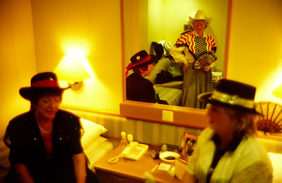 Guests on board the P&O Cruise Liner Oriana get ready for a Western theme dance in their cabin
