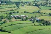 Farm buildings surrounded by countryside, Ormside, Cumbria, UK.
