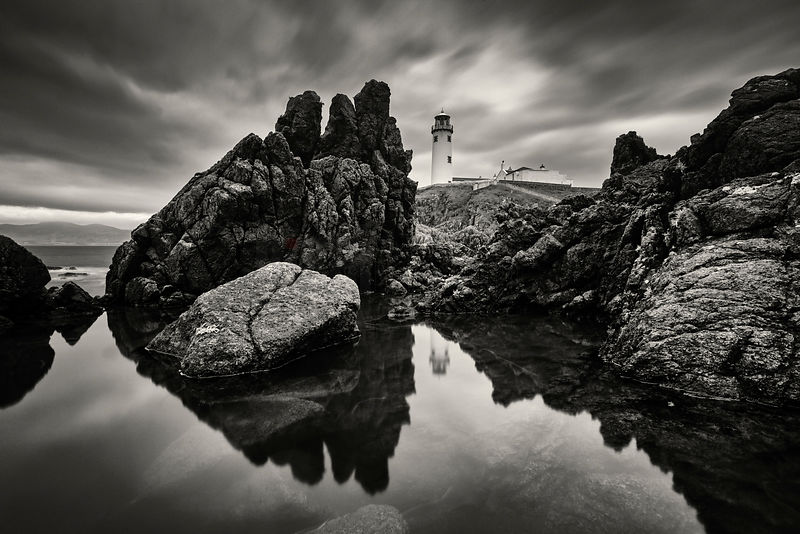 Reflection of Fanad Head Lighthouse in a Tidal Pool