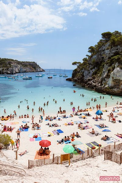 Cala Macarelleta full of people in summer, Menorca