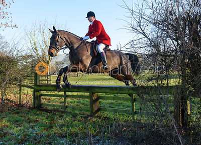 Nicholas Leeming jumping a hunt jump away from the meet - The Cottesmore Hunt at Pickwell Manor 28/12