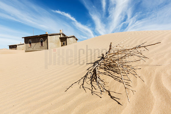 Sand Dunes and Old Buildings.