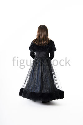 A Figurestock image of a little girl dressed as a princess, from Behind – shot from eye level.