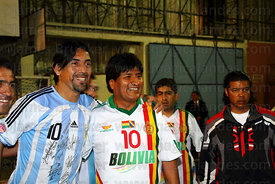 Bolivian president Evo Morales with a member of the Argentine embassy team at a futsal tournament, La Paz, Bolivia