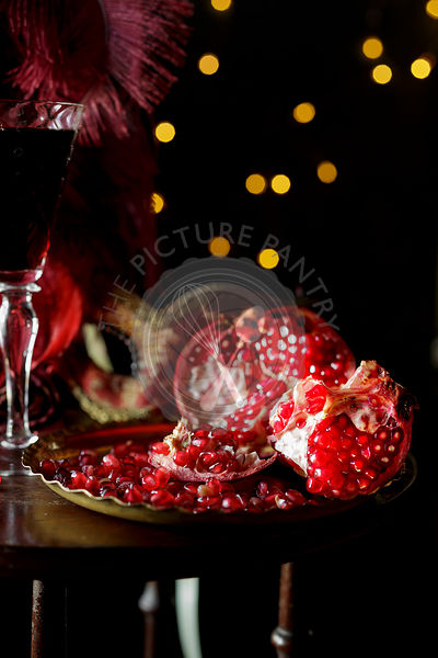 Pomegranate and wine, on a table