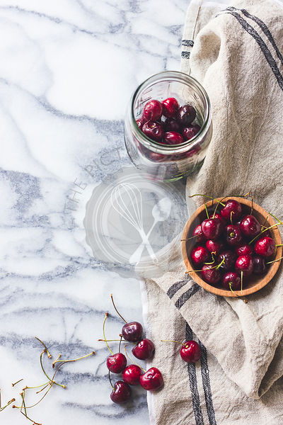 Cherries in a bowl and jar