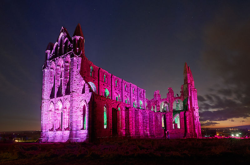Whitby Abbey illuminated in pink