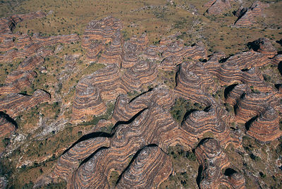Aerial view of Bungle Bungle range, eroded sandstone domes, Purnululu NP W Australia - beehive structures with bands of clay,...