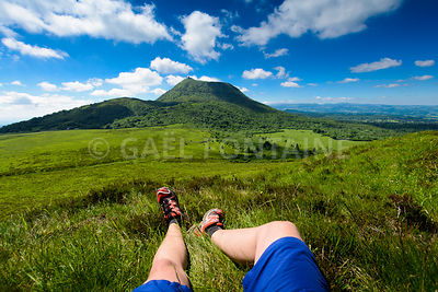 Puy de Dome mountain and hikers legs, Auvergne