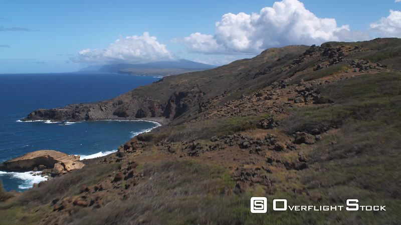 Over steep slopes of hills along the coastline of Molokai