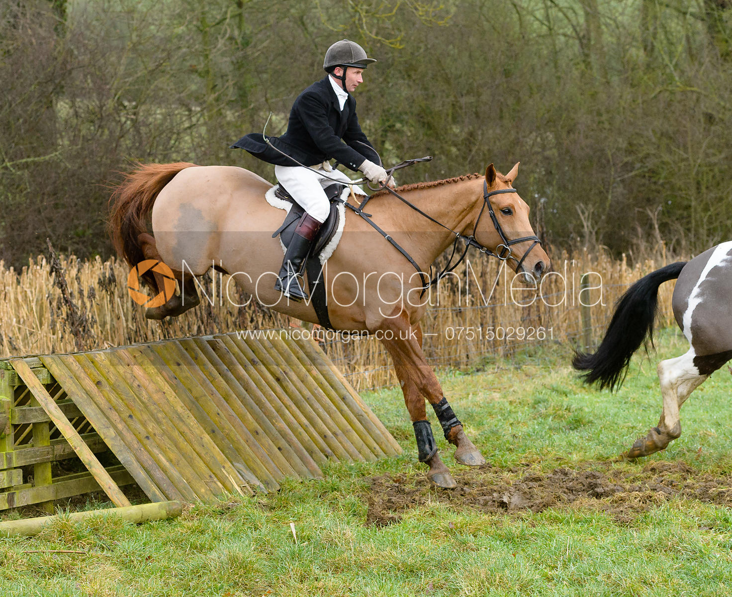 James Turcan jumping a hunt jump at Peakes - The Fitzwilliam Hunt visit the Cottesmore at Burrough House