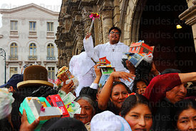 Priests blessing crowds of people and their miniatures with holy water outside San Francisco church, Alasitas festival, La Pa...