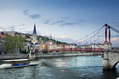 Footbridge and view of old city of Lyon before sunset, France