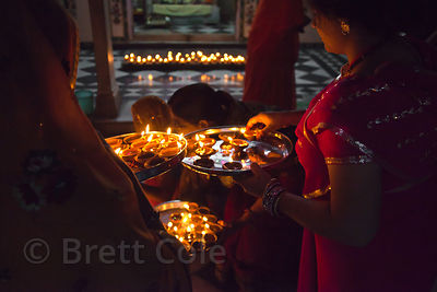 Candles being lit in a temple during Diwali, Jaipur, Rajasthan, India
