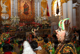 China Supay female devil diablada dancers paying homage to figure of Virgen del Socavón inside Sanctuary, Oruro Carnival, Bol...