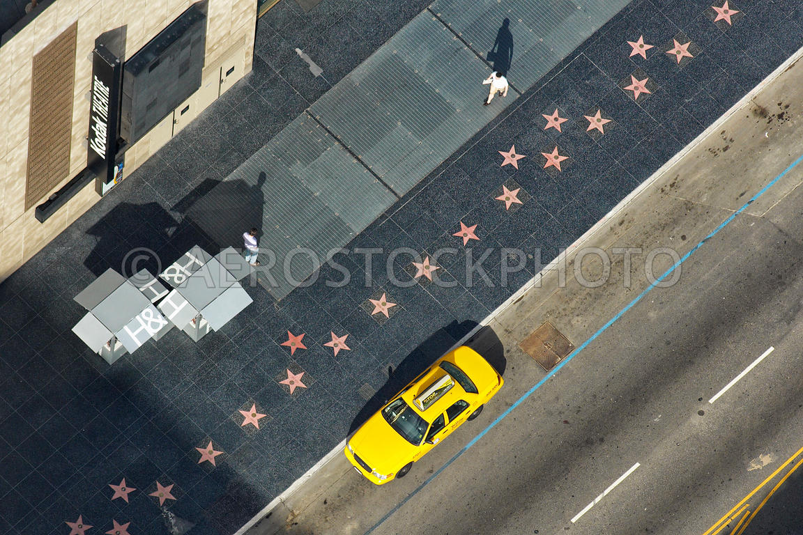 The Hollywood Walk of Fame with stars and a yellow cab, Hollywood Boulevard and the Kodak Theatre, Hollywood, California, USA.