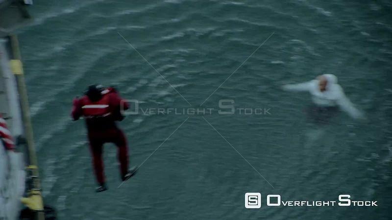 Aerial of a man jumping out of a rescue helicopter into the sea Cape Town Western Cape South Africa