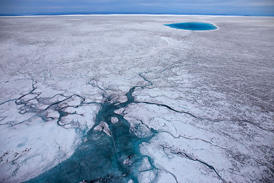 Aerial view of meltwater channels and meltwater lake on the ice cap north-east of Sermeq Kujalleq Glacier, Ilulissat Icefjord...