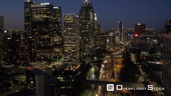 Downtown Los Angeles Flying Plates Buildings With Lights With Traffic Sunset California