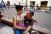 Italy - Verona - A couple become romantic on the street