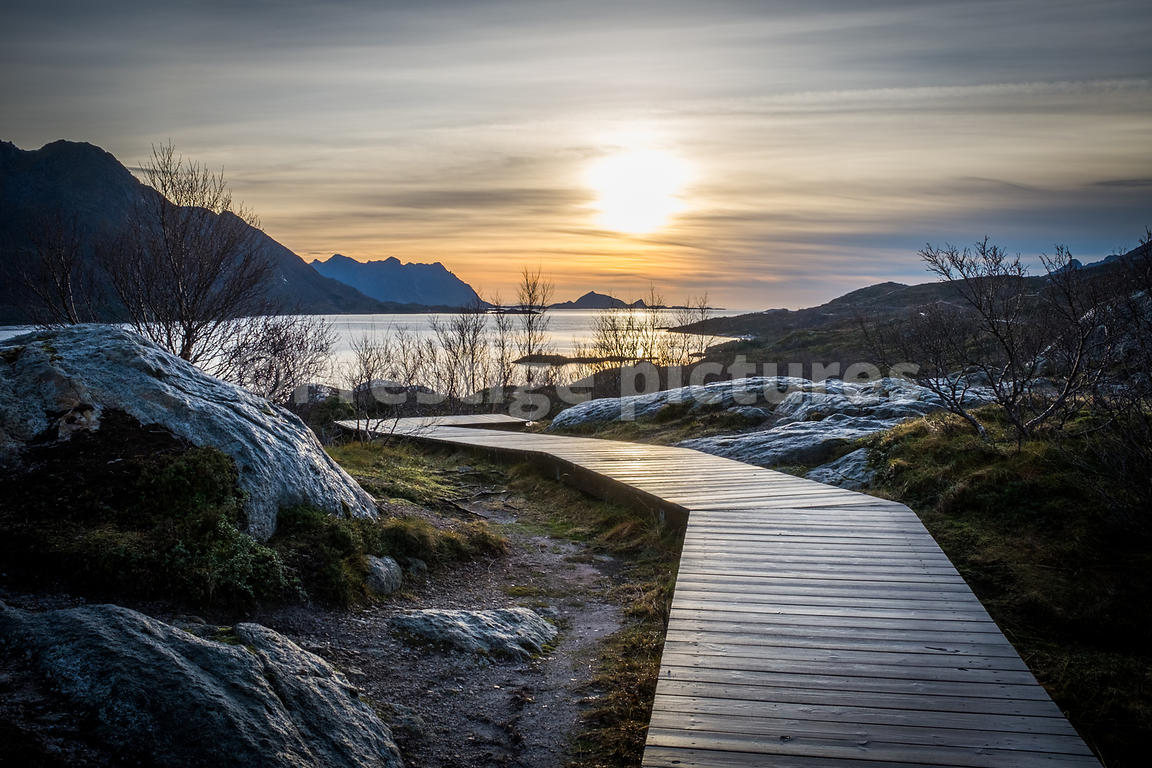 Boardwalk for tourists to find the best viewpoint in the area with the Arctic einter sun low in the sky