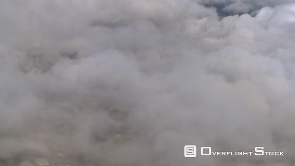 Steep descent through clouds, passenger POV