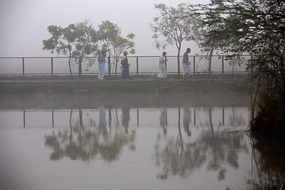 India - Cuddalore - Residents on their early morning walk around the pond at dawn