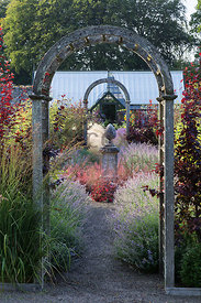 Series of archways punctuate the planting towards greenhouse