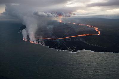 Lava erupting from fissure 8, Kilauea Volcano, near Pahoa, and flowing through agricultural plots to enter the ocean just sou...