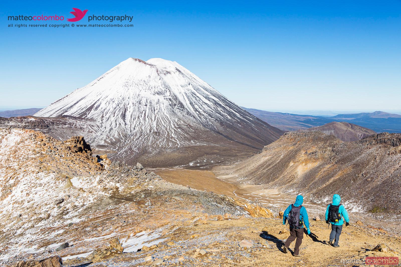 Two women hiking in front of Ngauruhoe volcano, New Zealand